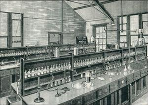 A typical, circa 1901, undergraduate laboratory showing the arrays of glass-stoppered reagent bottles.