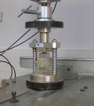 Dispositivo de ensayo a compresión.