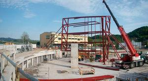 First structural sector, including two opposite truss panels, beams, and intermediate columns, as it was hoisted into position.