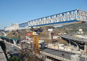 Launching girder measuring 120m long, with cantilevered front end.