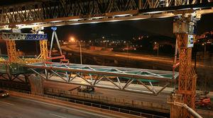 Placing a lattice girder into its final position using the launching gantry.