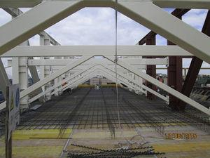 Supporting frames integrated into the roof structure.