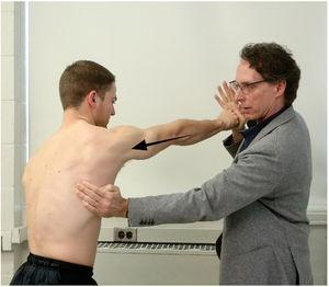 Muscle test for the serratus anterior (scapular protraction test). The examiner resists maximal-effort protraction of the scapula and the entire upper extremity.