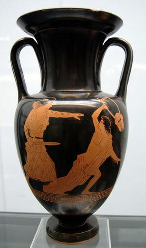 """Greek Red-Figure vase (450-440 B.C.) depicting the death of Orpheus by a sword-wielding, Thracian maenad bearing tattoos with geometric patterns on her bare arms. Amongst Thracian men, tattooing of men served as a marker of high social status and nobility that clearly distinguished the aristocracy from the peasantry. Conversely, the Greek essayist Plutarch suggests that Thracian women (Maenads), whose name roughly translates to the """"Mad Women"""" or """"Raving Ones, had been tattooed by their husbands as a punishment for killing Orpheus. Despite their misgivings about the practice, Ancient Greeks were also fascinated by the idea of tattoos. As a result, within the iconography of vase painting in the 5th and 4th centuries B.C., Greek artists frequently illustrated Thracian women wielding swords, spears, daggers and axes. On these vases, the geometric tattoos on the women's bodies draw attention to athletic strength and are used to accentuate musculature and motion."""
