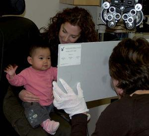 Teller acuity cards in use. The child is making a looking response to the left hand side of the card.
