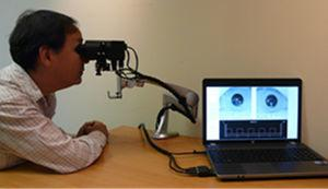 The Neuroptics DP-2000 laboratory-based, binocular pupillometer with subject being tested (used with permission, Neuroptics Inc.).