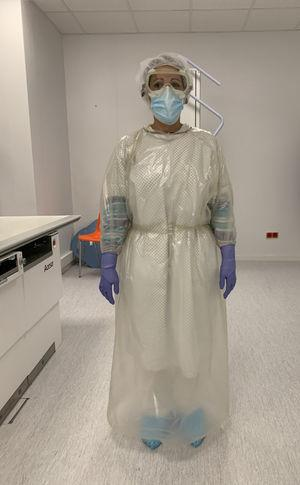 "Personal protective equipment. Senior diagnostic imaging technician showing the protective equipment worn in the ""COVID-19"" sector. See Table 1."