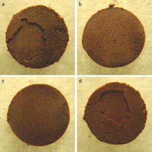 Photographs of the copper plates after the measurement of shear strength. The powders used were the metallic Cu particles (a)–(d) shown in Fig. 3.