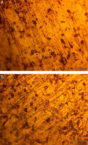 Optical image (mag. 40×) of 43035SS after corrosion in 6% NaCl (a) at 308K, (b) at 378K.