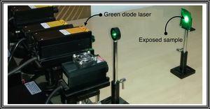 Experimental demonstration of illumination of sample of glassy Se76Te20Sn2Cd2 alloy by green diode laser having wavelength 532nm.