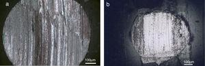 Optical images of the ball scar after wear test against (a) uncoated and (b) coated composite samples.