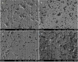 Wear craters in borided specimens after 1200 revolutions: (a) 0.49N, 0.5g/cm3&#59; (b) 0.49N, 1.0g/cm3&#59; (c) 0.98N, 0.5g/cm3&#59; (d) 0.98N, 1.0g/cm3.