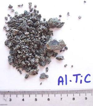 Al/TiC master alloy produced by SHS containing 40wt.% of pure free aluminium manually crushed before the ball milling process.