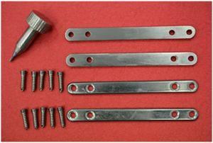 Prototypes made of casted Ti25Nb10Zr: plate for osteosynthesis, screw and screwdriver.