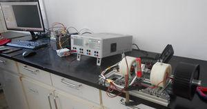 In-house developed system to determine electrical conductivity and torque friction of greases in ball bearings.