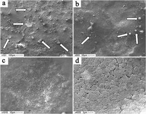 Surface structure of silumin subjected to the complex treatment by mode No. 2. The arrows point to thin-film formations (а) and to particles of a circular droplet fraction (b). Scanning electron microscopy.