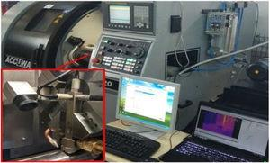 CNC lathe and MQL system experimental setup.