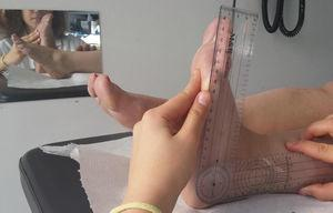 Measurement of ankle dorsiflexion with the goniometer.